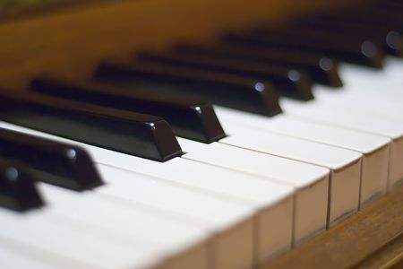 ivories: Blurred classic piano keyboard background.