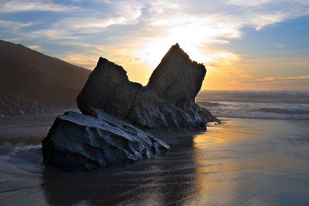 big black rock on sunset sea background Stock Photo - 669191