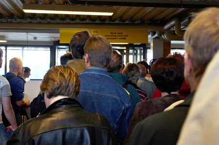 queue at the airport to passport control Stock Photo