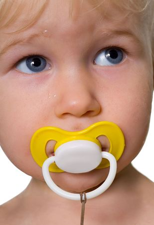 closeup portrait of handsome little grey-eyed blonde girl with dummy in mouth photo