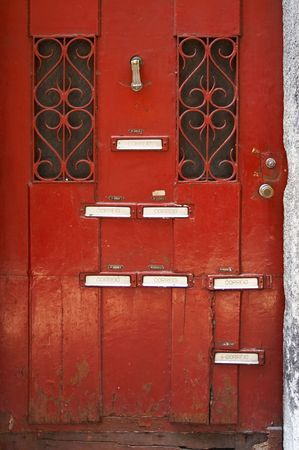 lodger: closeup of red old door with blank of lodgerss names