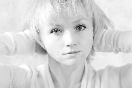 Hi-key black-and-white portrait of the smiling beautiful blonde girl. Small DOF. Stock Photo - 770281