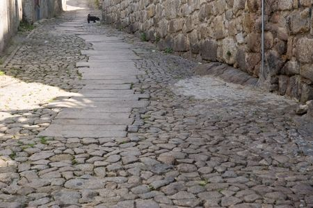stone cobbles and stone walls of old street, Porto, Portugal photo