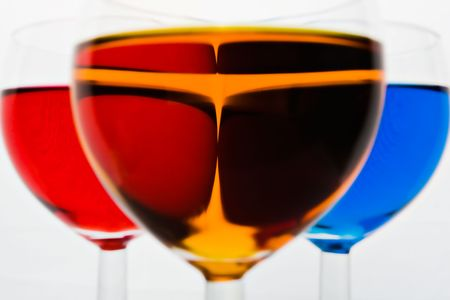 Three glasses with color drinks on white background photo