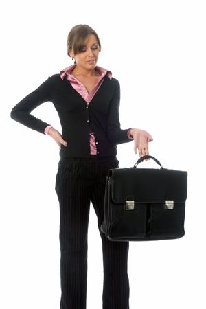 ponderous: young business woman in black suit with big heavy briefcase in hand, isolated on white
