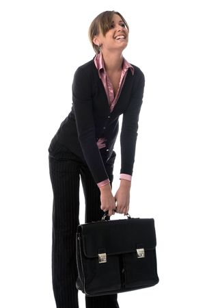 ponderous: young business woman in black suit with big heavy briefcase in hands, isolated on white Stock Photo
