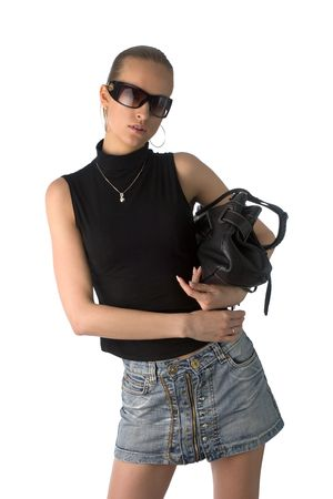young beautiful woman in black t-shirt, short skirt and sunglasses, with black leather handbag, isolated on white Stock Photo - 1067888