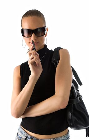 young beautiful woman in black t-shirt, short skirt and sunglasses, with black leather handbag, isolated on white photo