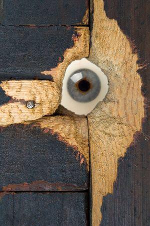 investigators: spy eye behind a hole in wood door