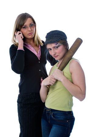 mobilephones: businesswoman with mobile phone  and young aggressive woman with baseball bat, isolated on white