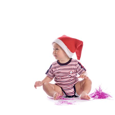 cute baby with santa claus red hat, isolated on white photo