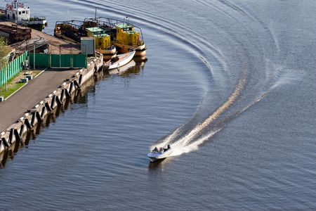 high speed motor boat with wave trail on the water Stock Photo - 1356635