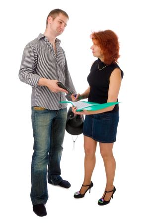 merciless: woman signing business papers under pressure of young man with a gun, isolated on white Stock Photo