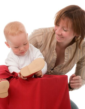 happy mother and little son sitting on big red box with Christmas presents photo