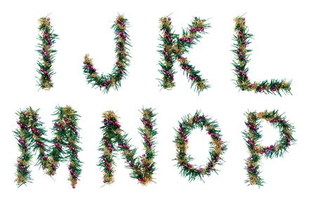 christmas decorative alphabet. letters. fir branches, red balls and golden tinsel. isolated. photo