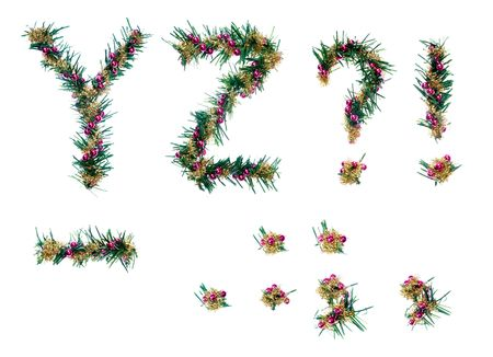 christmas decorative alphabet. letters and punctuation. fir branches, red balls and golden tinsel. isolated. photo
