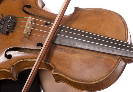 fiddlestick: primer de madera tocando el viol�n con cuerdas de fiddlestick Foto de archivo