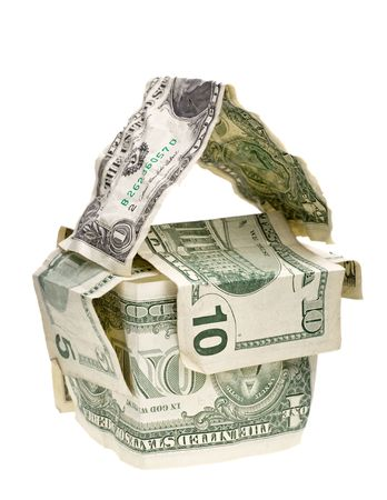 conceptual house made from crumpled dollar banknotes isolated on white photo
