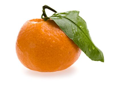 closeup of fresh orange tangerine with green leaf and drops of water isolated on white photo