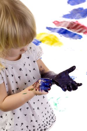 dirty hands: little girl with very dirty hands after painting