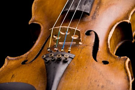 old violin close-up isolated on black background photo