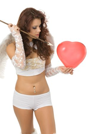 beautiful girl in white underwear and angel wings going to spear heart-like red balloon by cupid arrow isolated on white photo