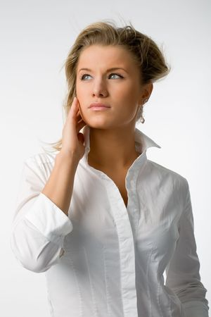 young beautiful woman in white shirt on white background