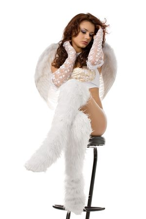 beautiful young girl like an angel in high white fur boots and wings isolated on white