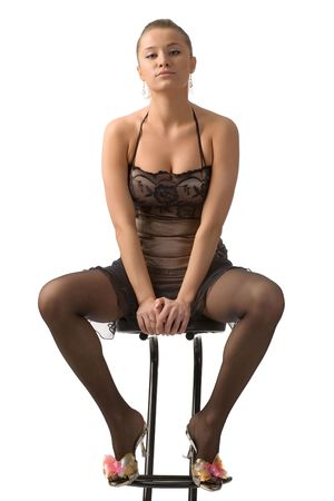 beautiful girl in black underwear sitting on bar chair isolated on white photo