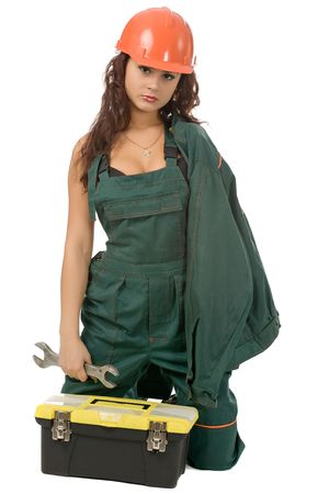 beautiful woman in green coverall with screw key isolated on white photo