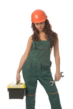 screw key: beautiful woman in green coverall with screw key isolated on white Stock Photo