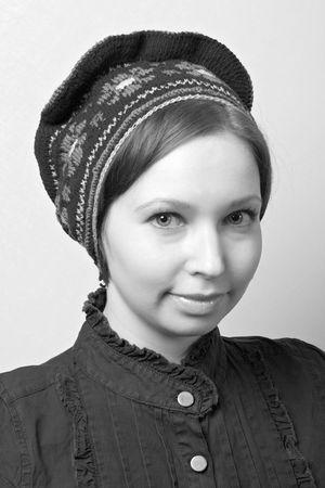 portrait of woman in blouse and hat in Scandinavian folk style photo