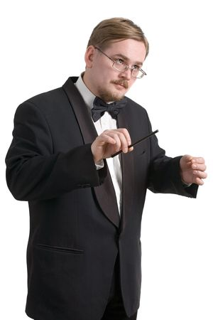 Young  conductor in black tuxedo, isolated on white