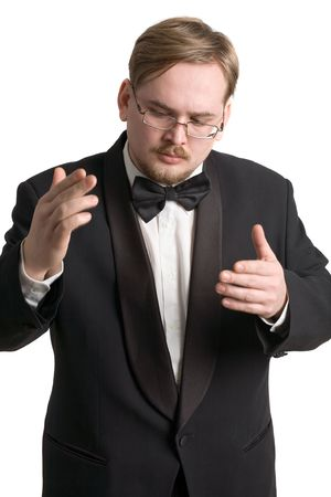 Young  conductor in black tuxedo, isolated on white photo