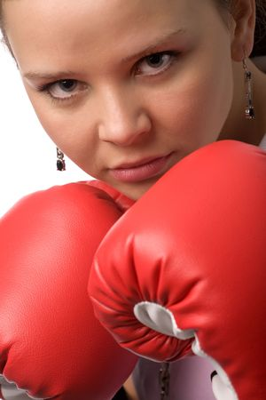 serious woman in red boxing gloves closeup photo