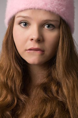 young beautiful woman in pink hat close-up portrait photo