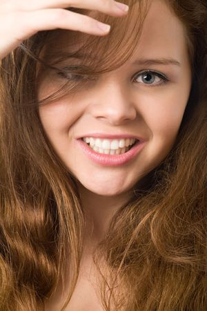 close-up of young girls face with beautiful smile photo