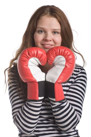 young beautiful longhaired woman with hands in boxing gloves look like human heart, isolated on white photo