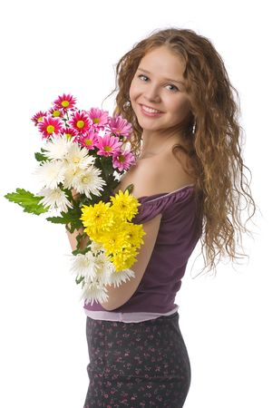 portrait of smiling beautiful young woman with spring flowers photo