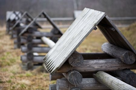 village fence made from wooden logs with small turrets in Russian style photo