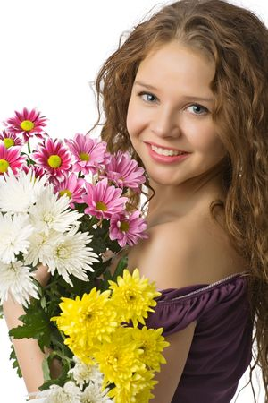 portrait of smiling beautiful young woman with spring flowers Stock Photo