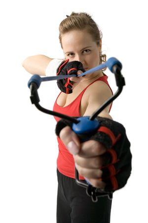 strained: aiming woman with big tight slingshot in hands isolated on white