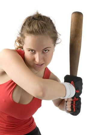 furious woman in red t-shirt with baseball bat in hands photo