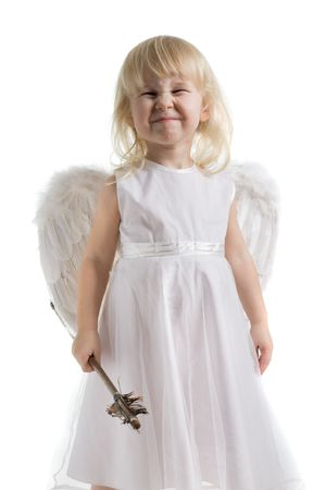little girl with Cupid arrow in hand in white dress and angel wings photo