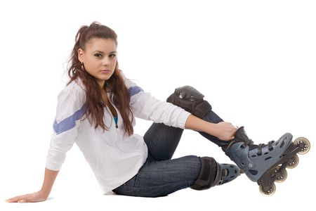 sitting young beautiful woman in roller skates isolated on white