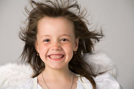 happy little girl in white dress and angel wings Stock Photo - 3091741