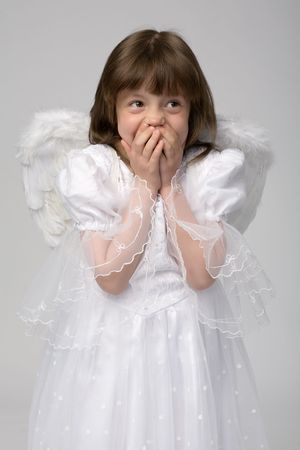 surprised girl in white dress with angel wings photo