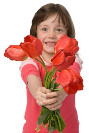 happy little girl with tulips in hands isolated on white photo