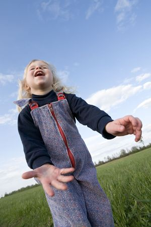 toddler girl on green summer meadow and blue sky background Stock Photo - 3105895