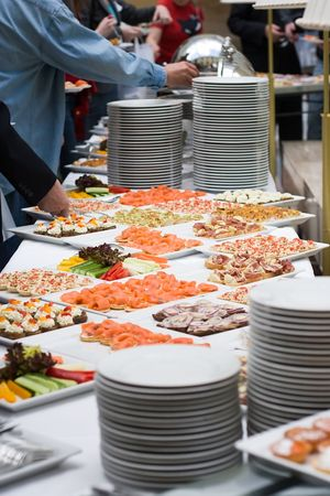 fare: table with a lot of food for stand-up meal in a buffet